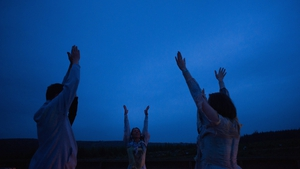 A dance group performs for visitors at Kielder Observatory in England to mark the summer solstice