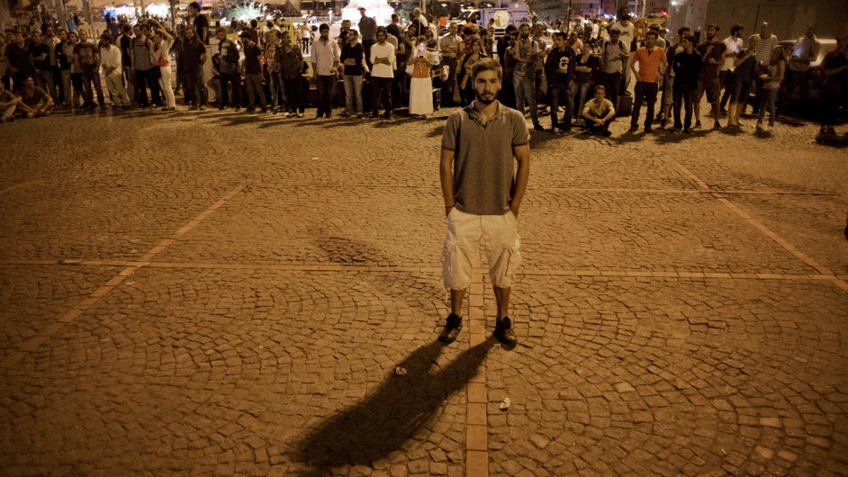 A man stands for a lone protest on Taksim square in Istanbul, Turkey