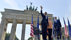50 years after JFK's famous visit to Berlin, US President Barack Obama walks in his footsteps at the Brandenburg Gate