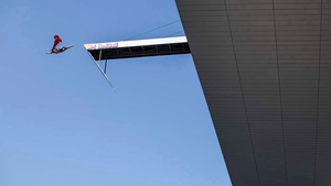 Michal Navratil of the Czech Republic performs his Superman dive from the 28-metre platform on the roof of the Copenhagen Opera House
