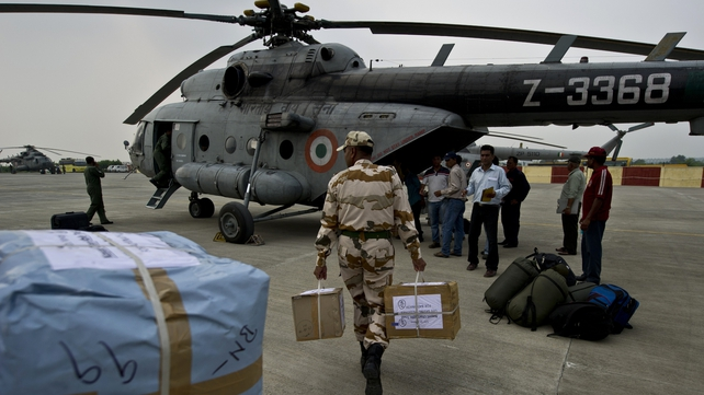 Indian military personnel load relief supplies for flood-hit areas in the state capital of Uttarakhand