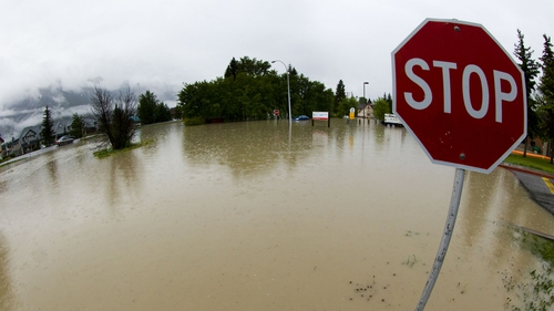 The front entrance to a hospital is overcome with water due to heavy flooding in Canmore, Alberta