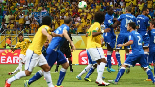 Neymar curls the ball to the back of the net from a free-kick
