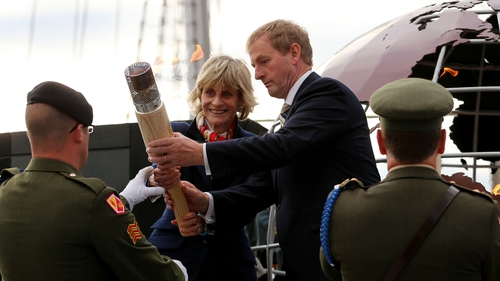 The eternal flame from JFK's grave is delivered by Jean Kennedy Smith and Taoiseach Enda Kenny