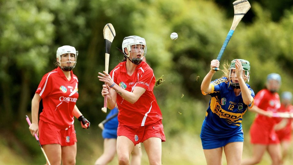 Tipperary's Brid Quinn attempts to block down Aisling Thompson of Cork during their Senior Camogie Championship tie