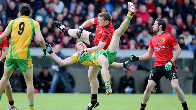 Donegal's Ryan Bradley and Calum King of Down contest possession