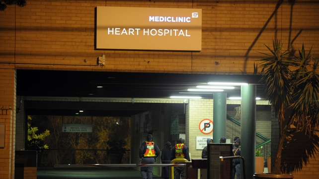 Police stand guard outside the Mediclinic Heart Hospital where the former South African president is being treated