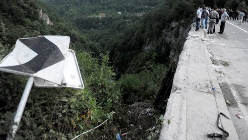 Onlookers at the scene where a bus crashed into a gorge in Montenegro yesterday, leaving 18 people dead