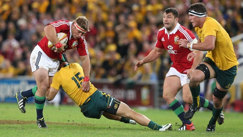 Tom Youngs is tackled by Berrick Barnes during the first Test in Brisbane