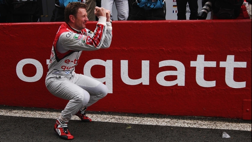Allan McNish celebrates victory in the Le Mans 24 Hours