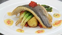 Pan Seared Sea Bass - Kamal Ibrahim serves up pan seared sea bass with sautéed, lightly spiced baby potatoes served with grilled