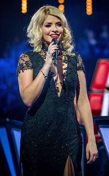 The BBC apologised after receiving over 100 complaints from viewers about Holly Willoughby's low-cut, black lace dress on the final of The Voice UK