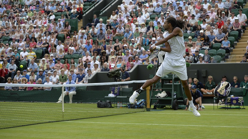 Dustin Brown leaps to return against Lleyton Hewitt
