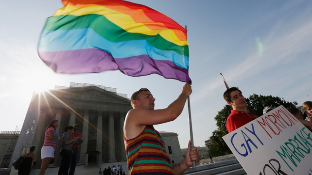 Gay rights activists gathered in front of the US Supreme Court building in Washington