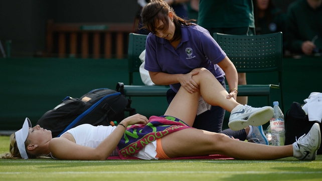 Maria Sharapova receives attention during her second-round defeat