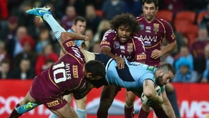Aaron Woods is tackled during game two of the ARL State of Origin series between the Queensland Maroons and the New South Wales Blues