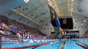 Nathan Adrian dives in on his way to winning the men's 100m freestyle finals at the USA Swimming National Championships