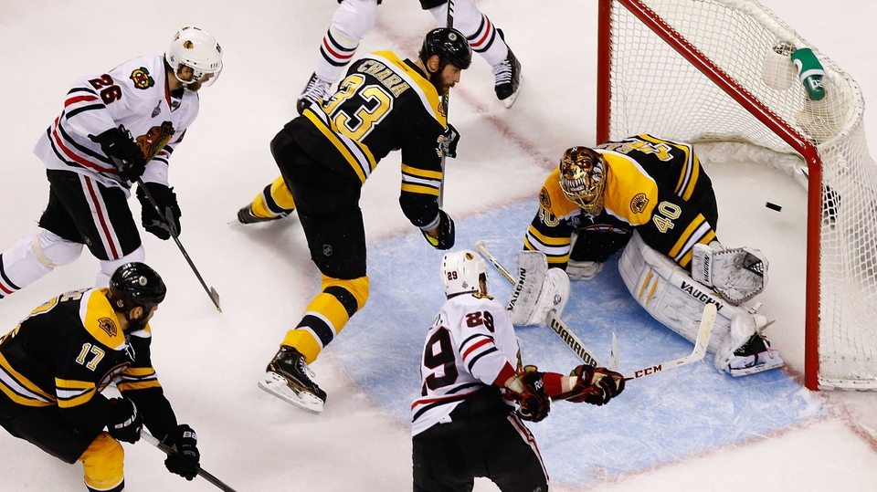 Bryan Bickell of the Chicago Blackhawks scores a goal against Boston Bruins during Game Six of the Stanley Cup Final