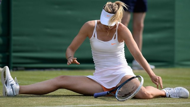 Maria Sharapova was one of a number of players to struggle to maintain their footing at SW19