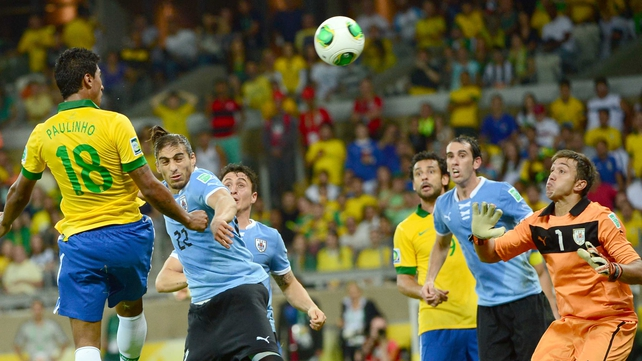 Brazil's midfielder Paulinho heads the Selecao into the final