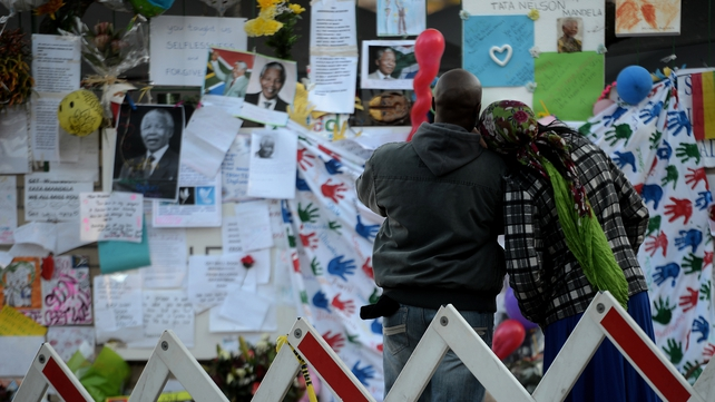 South Africans leave tributes outside the Mediclinic Heart hospital, Pretoria