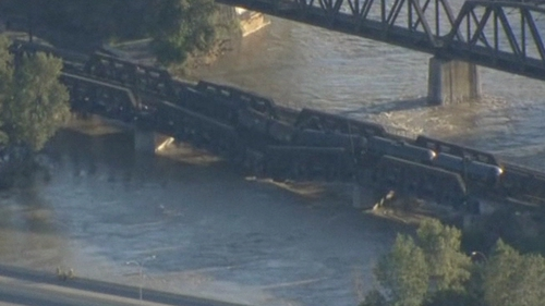 The carriages were left perched close to the water after the derailment
