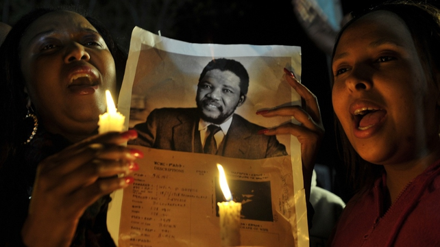 Hundreds of people are holding a vigil for Nelson Mandela outside the hospital in Pretoria
