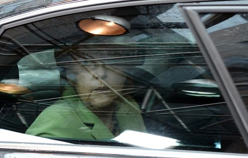 Angela Merkel arriving for EU summit  where Germany succeeded in avoiding a vote on strict new car emissions levels