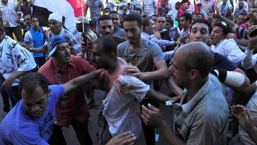 Violence between supporters and opponents of Egyptian president Mohammed Mursi has left one man dead and 70 injured