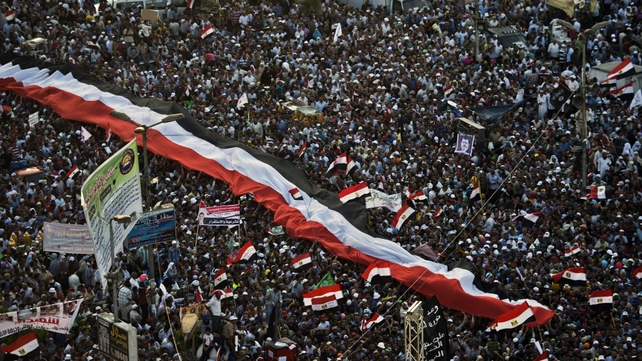 Supporters Mohammed Mursi and the Muslim Brotherhood gather during a demonstration next to the Rabaa El-Adaweya mosque in  Cairo