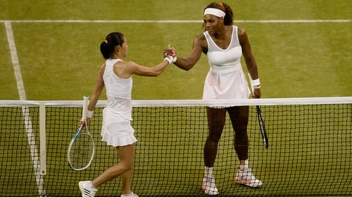 Serena Williams shakes hands with Kimiko Date-Krumm after their match