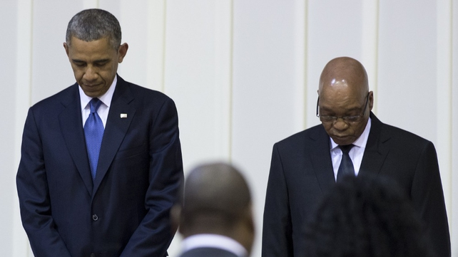 Barack Obama and Jacob Zuma bow their heads during a moment of prayer for Nelson Mandela during an official dinner in Pretoria last night