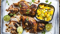 Jerk Chicken with Mango Salsa - If you've never had Jerk chicken before and were wondering what all the fuss was about, well, you are in for a treat. The spicy and earthy marinade produces the most delicious tender chicken you will ever have. Served with a cooling and sweet mango salsa, this is one of my ultimate summer dishes.