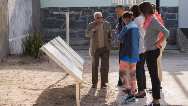 The Obama family gets a tour of Robben Island from a former inmate