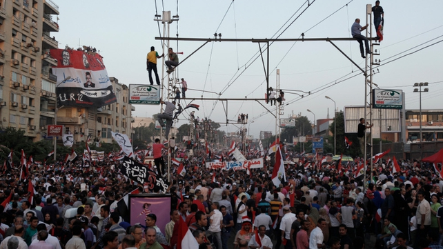 Egyptian opposition protesters fill a street during a demonstration as part of the 'Tamarod' or rebel campaign