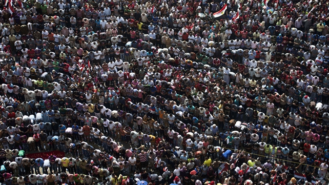 Opponents of Mohammed Mursi pray during a protest in Cairo's Tahrir Square
