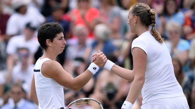 Petra Kvitova shakes hands at the net with Carla Suarez Navarro