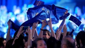 Croatians wave EU flags as they celebrate the accession of Croatia to the European Union