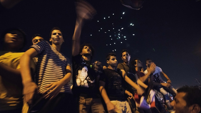Egyptians shout slogans against President Mohammed Mursi outside the Presidential Palace in Cairo