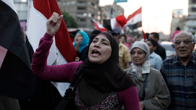 Opposition protesters demonstrate at the Presidential Palace in the suburb of Heliopolis