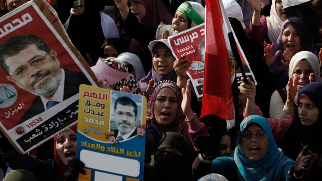 Mursi supporters demonstrate at the Rabaa al Adawiya Mosque in the suburb of Nasr City in Cairo