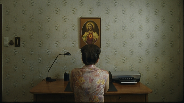 Anna Maria prays before the Sacred Heart in her sterile Viennese apartment