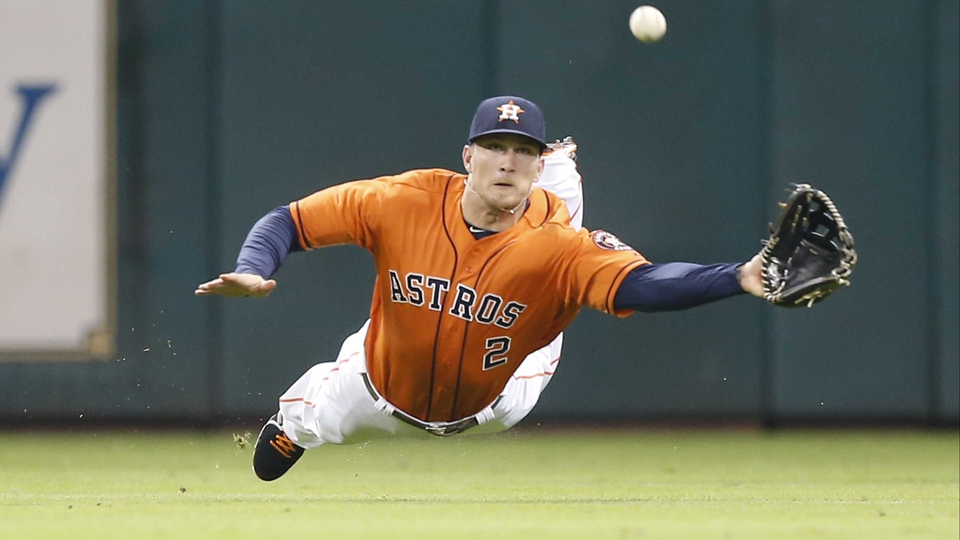Brandon Barnes of the Houston Astros makes a diving catch against the Los Angeles Angels in Houston, Texas