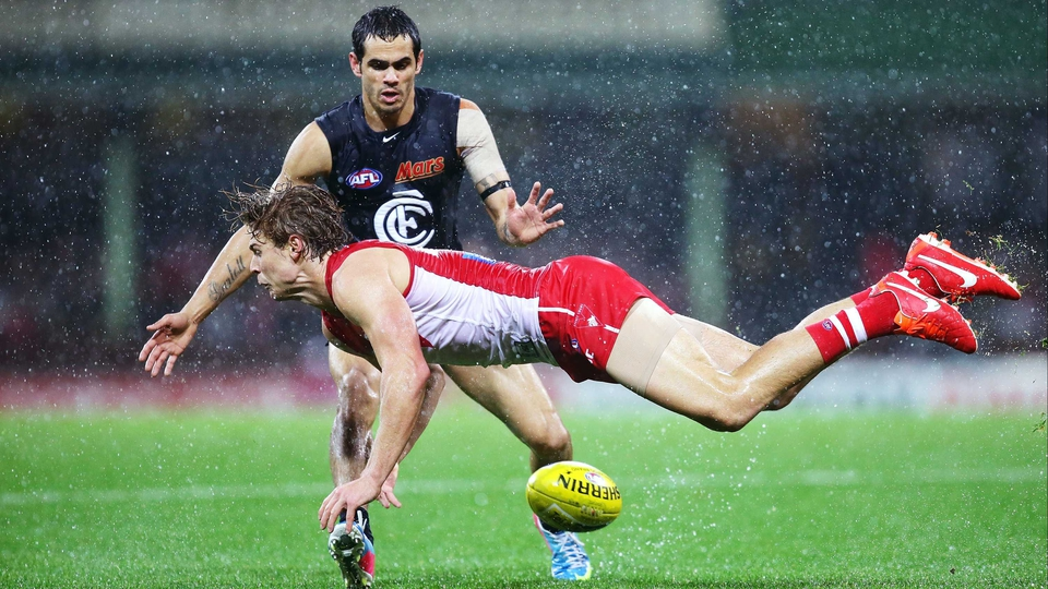 Dane Rampe of the Swans is challenged by Jeff Garlett of the Blues during an AFL match at the SCG, Sydney