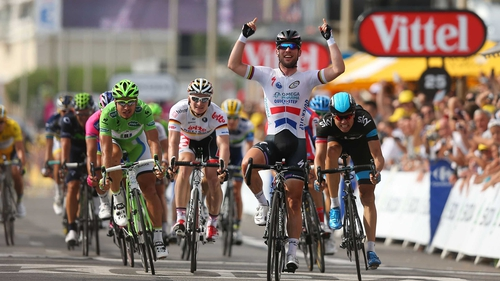 Mark Cavendish celebrates winning a Tour de France stage for the 25th time