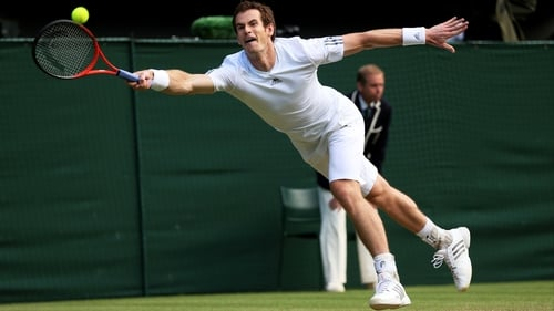 Andy Murray battled back from two sets down to claim a semi-final place
