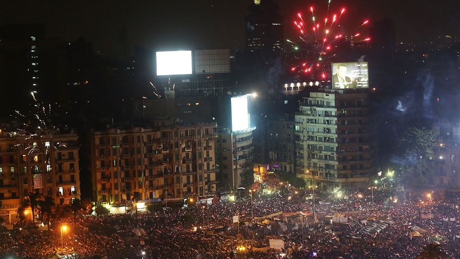 Fireworks and cheering erupted in Cairo's Tahrir Square