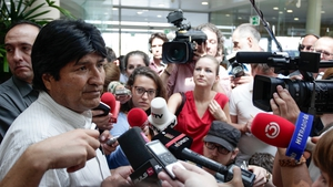 Evo Morales speaks to reporters in the airport in Vienna