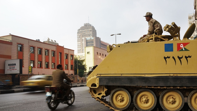 The Egyptian military stands guard at a roadblock in the district of Giza