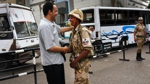 A member of the Egyptian military is greeted in support by a pedestrian in the district of Giza